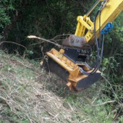 Flail mulcher clearing a bank