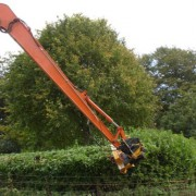 Flail mulcher maintaing hedges