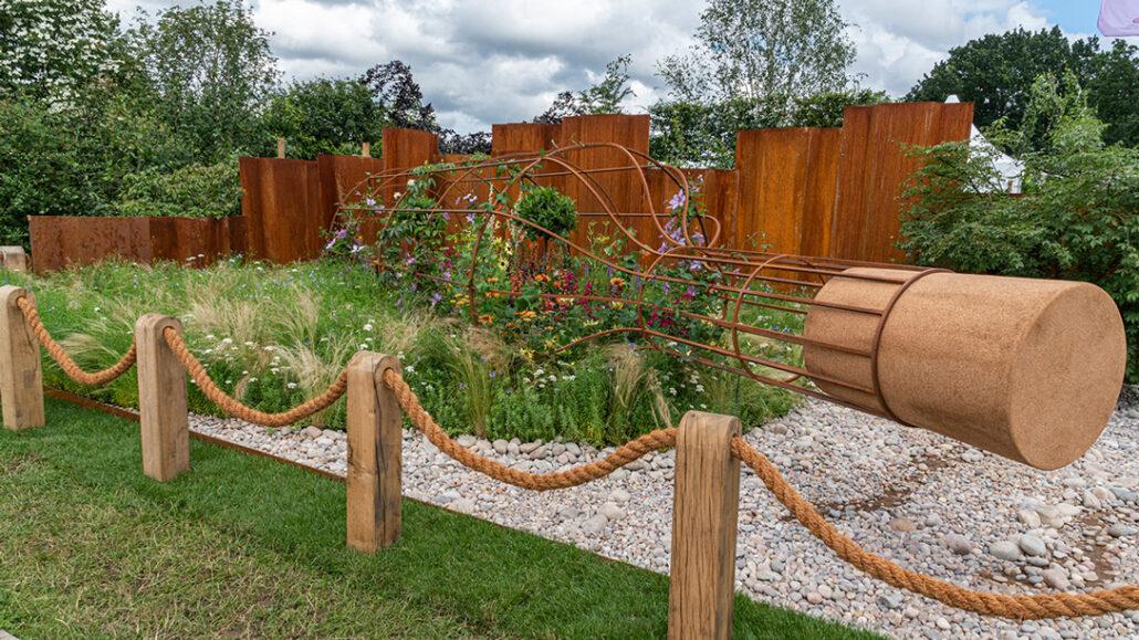 Award winning design from Tracy Foster at Hampton Court Garden Festival featuring a giant metal framed bottle containing a beautiful garden